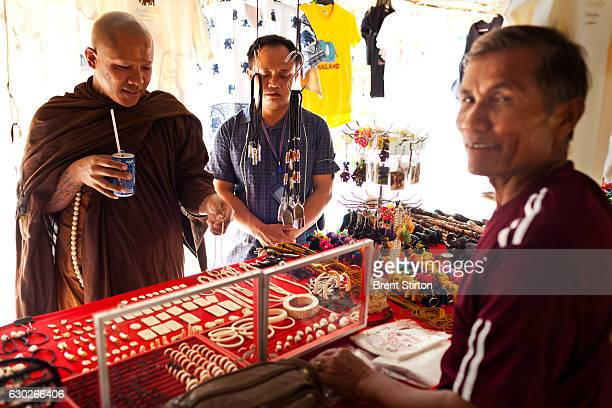 Luang Poo Bru Ba Dhammamunee head abbot of Wat Suan Paa Phutthasatharn Supraditme thee Temple cruises the ivory market looking for bargains in Surin...