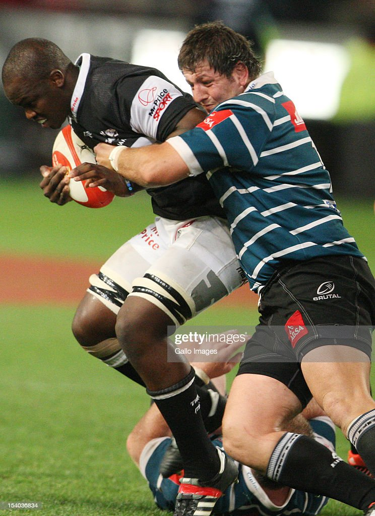 Lubabalo Tera Mtembu is tackled by Steph Roberts during the Absa Currie Cup match between The Sharks and GWK Griquas at Mr Price KINGS PARK on October 12, 2012 in Durban, South Africa.
