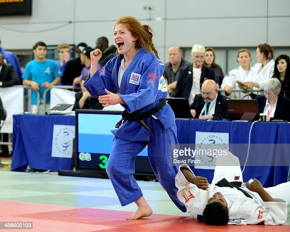 Lubjana Piovesana of Bishop Challoner JC joyfully rises to her feet after throwing Prisca Awiti of Enfield JC for ippon in extra time on her way to...