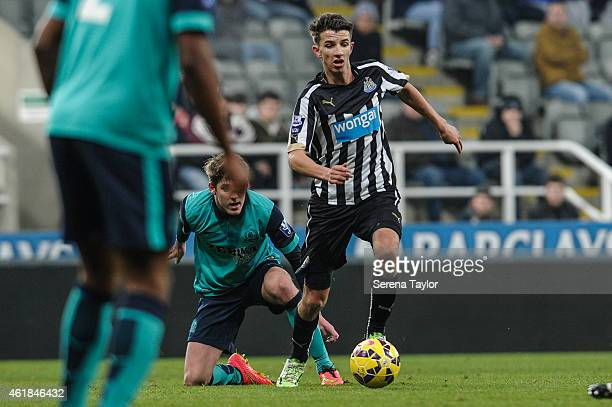 Lubomir Satka of Newcastle runs past Blackburn Rovers Connor Mahoney during for the U21 Premier League Cup Quarter Final match between Newcastle...