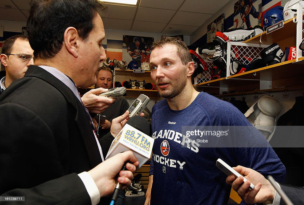 Lubomir Visnovsky #11 of the New York Islanders answers questions from reporters after the game against the Buffalo Sabres at Nassau Veterans Memorial Coliseum on Febuary 9, 2013 in Uniondale, New York. The Sabres defeated the Islanders 3-2.
