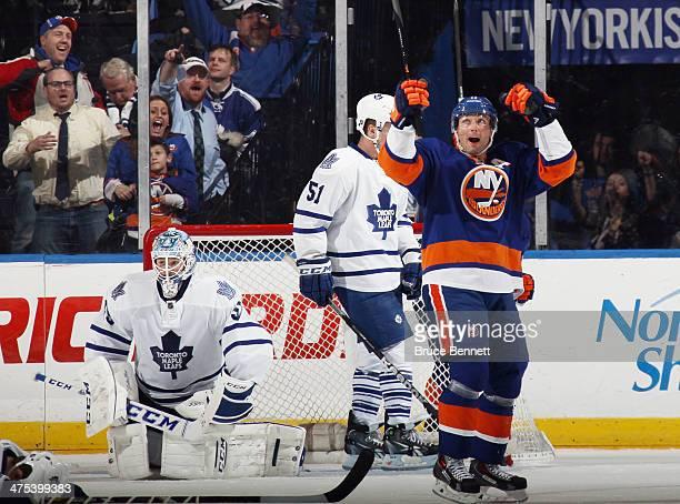 Lubomir Visnovsky of the New York Islanders celebrates his game winning goal at 155 of overtime against Jonathan Bernier of the Toronto Maple Leafs...