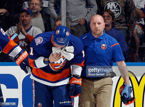 Lubomir Visnovsky of the New York Islanders leaves the game after a hit by Tom Wilson of the Washington Capitals during the second period in Game...
