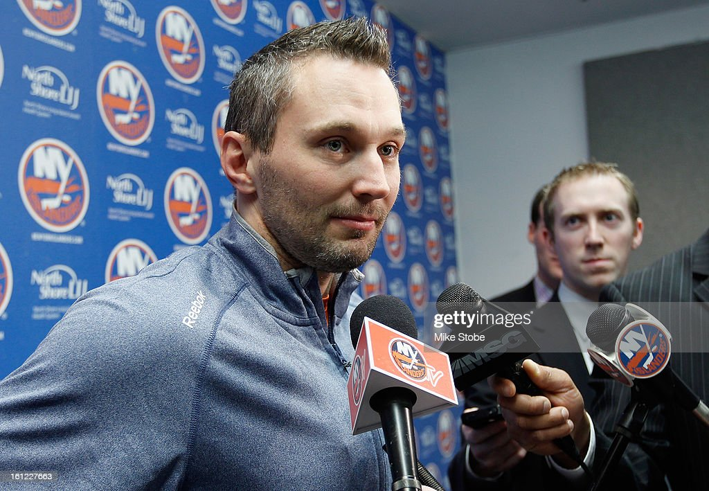 Lubomir Visnovsky #11 of the New York Islanders speaks to the media prior to the game against the Buffalo Sabres at Nassau Veterans Memorial Coliseum on Febuary 9, 2013 in Uniondale, New York.