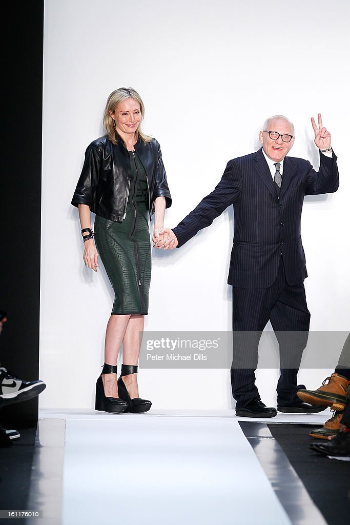Lubov Azria and husband Max Azria walk the runway at the Herve Leger by Max Azria Fall 2013 fashion show during Mercedes-Benz Fashion Week at The Theatre at Lincoln Center on February 9, 2013 in New York City.