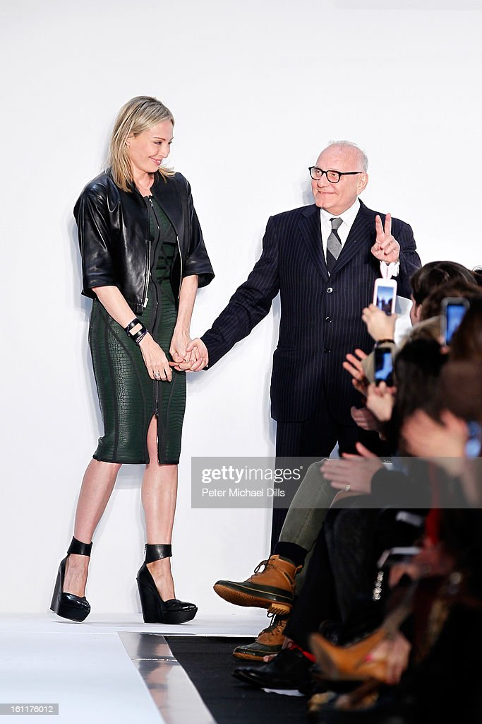 <a gi-track='captionPersonalityLinkClicked' href=/galleries/search?phrase=Lubov+Azria&family=editorial&specificpeople=2281952 ng-click='$event.stopPropagation()'>Lubov Azria</a> and husband Max Azria walk the runway at the Herve Leger by Max Azria Fall 2013 fashion show during Mercedes-Benz Fashion Week at The Theatre at Lincoln Center on February 9, 2013 in New York City.