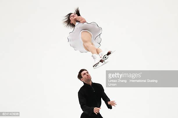 Lubov Iliushechkina and Dylan Moscovitch of Canada compete in the Pairs Short Program on day one of Audi Cup of China ISU Grand Prix of Figure...