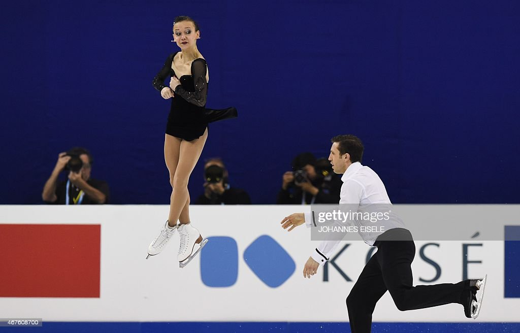 Lubov Iliushechkina (L) and <a gi-track='captionPersonalityLinkClicked' href=/galleries/search?phrase=Dylan+Moscovitch&family=editorial&specificpeople=7301055 ng-click='$event.stopPropagation()'>Dylan Moscovitch</a> of Canada perform during their pairs free skating of the 2015 ISU World Figure Skating Championships at Shanghai Oriental Sports Center in Shanghai on March 26, 2015. AFP PHOTO / JOHANNES EISELE