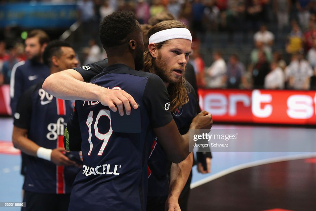 Luc Abalo of Paris (L) hugs Mikkel Hansen after the third place play-off at the EHF Final4 between Paris St.-Germain and THW Kiel on May 29, 2016 in Cologne, Germany.