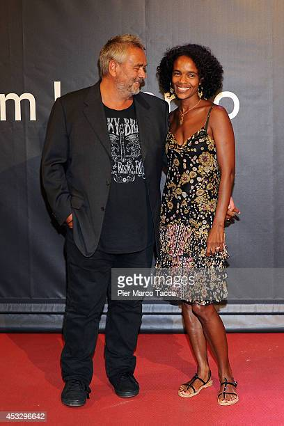 Luc Besson and his wife Virginie Silla attend 'Lucy' Premiere on August 6 2014 in Locarno Switzerland