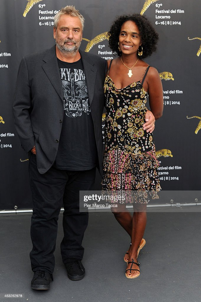 <a gi-track='captionPersonalityLinkClicked' href=/galleries/search?phrase=Luc+Besson&family=editorial&specificpeople=226803 ng-click='$event.stopPropagation()'>Luc Besson</a> and his wife <a gi-track='captionPersonalityLinkClicked' href=/galleries/search?phrase=Virginie+Silla&family=editorial&specificpeople=4291594 ng-click='$event.stopPropagation()'>Virginie Silla</a> attend the 'Lucy' photocall during the 67th Locarno Film Festival on August 6, 2014 in Locarno, Switzerland.