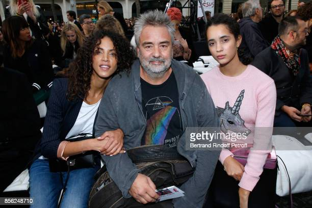 Luc Besson sitting between his nieces Noemie Lenoir and Iman Perez attend 'Le Defile L'Oreal Paris show' as part of the Paris Fashion Week Womenswear...