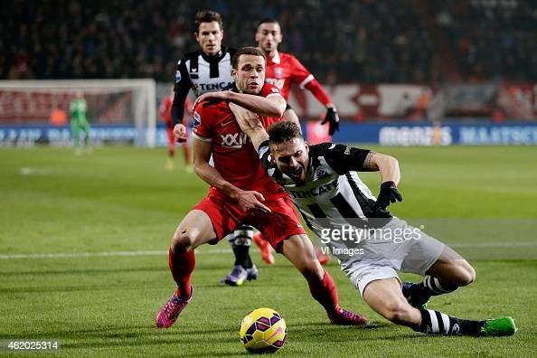 Luc Castaignos of FC Twente Bart Schenkeveld of Heracles Almelo during the Dutch Eredivisie match between FC Twente and Heracles Almelo at the...