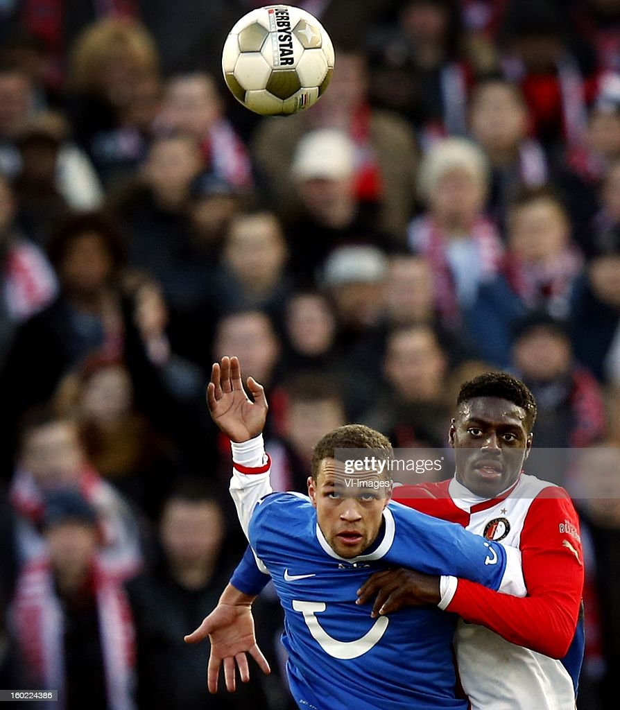 Luc Castaignos of FC Twente (L), Bruno Martins Indi of Feyenoord (R) during the Dutch Eredivise match between Feyenoord and FC Twente at stadium De Kuip on January 27, 2013 in Rotterdam, The Netherlands.