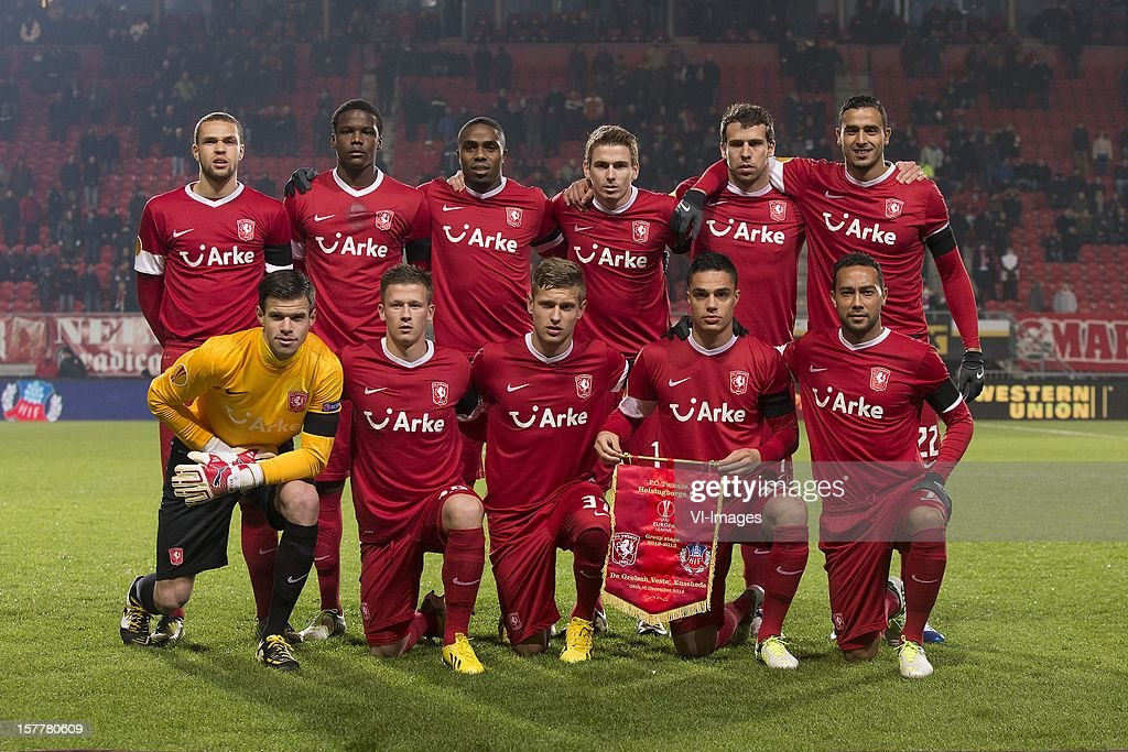Luc Castaignos of FC Twente, Dedryck Boyata of FC Twente, Edson Braafheid of FC Twente, Tim Breukers of FC Twente, Peter Wisgerhof of FC Twente, Nacer Chadli of FC Twente Goalkeeper Filip Bednarek of FC Twente, Mirco Born of FC Twente, Tim Holscher of FC Twente, Joey Pelupessy of FC Twente, Denny Landzaat of FC Twente during the Europa League match between FC Twente and Helsingborgs IF at the Grolsch Veste on December 6, 2012 in Enschede, The Netherlands.
