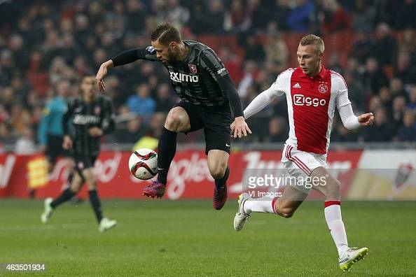 Luc Castaignos of FC Twente Mike van der Hoorn of Ajax during the Dutch Eredivisie match between Ajax Amsterdam and FC Twente at the Amsterdam Arena...