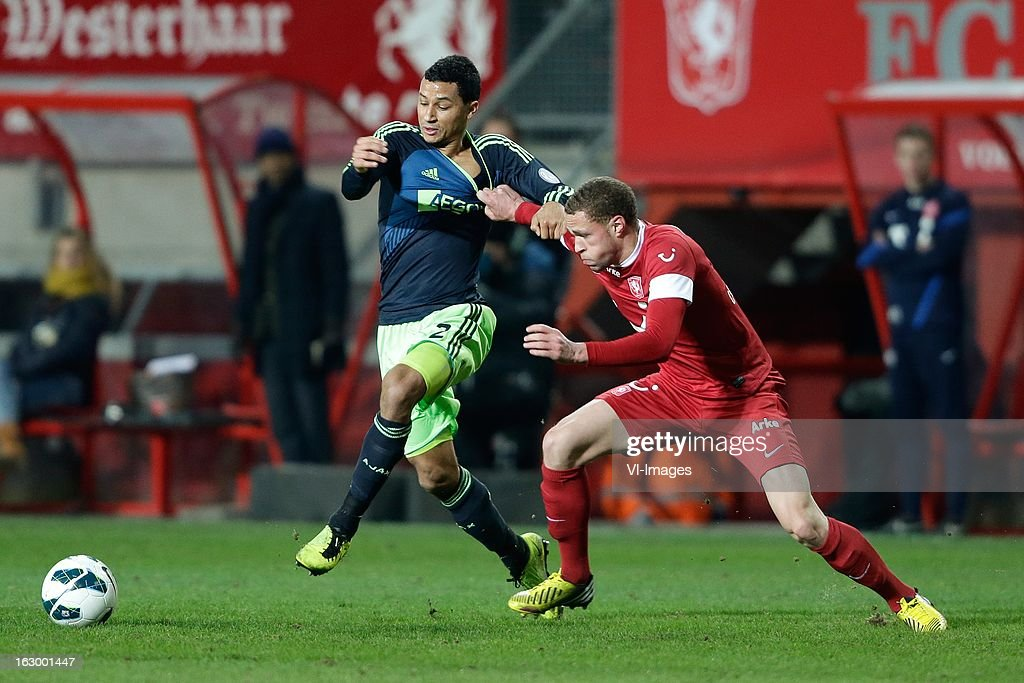 Luc Castaignos of FC Twente (R) Ricardo van Rhijn of Ajax (L) during the Dutch Eredivisie match between FC Twente and Ajax Amsterdam at the Grolsch Veste on march 02, 2013 in Enschede, The Netherlands