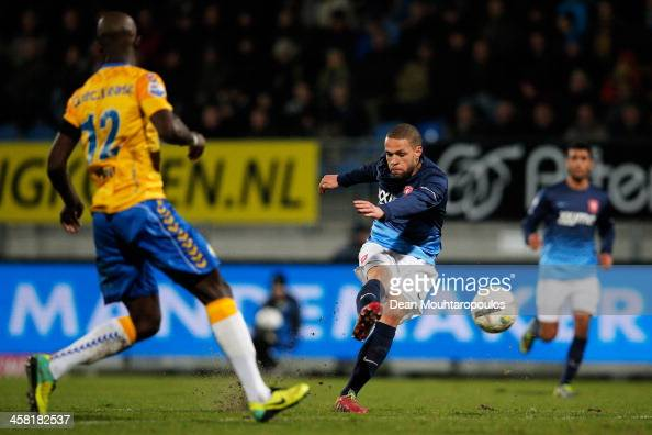 Luc Castaignos of FC Twente shoots and scores his teams first goal during the Eredivisie match between RKC Waalwijk and FC Twente at the Mandemakers...