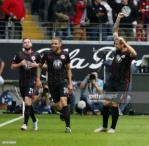 Luc Castaignos of Frankfurt celebrates after scoring his team's second goal with his teammate Marco Russ during the Bundesliga match between...