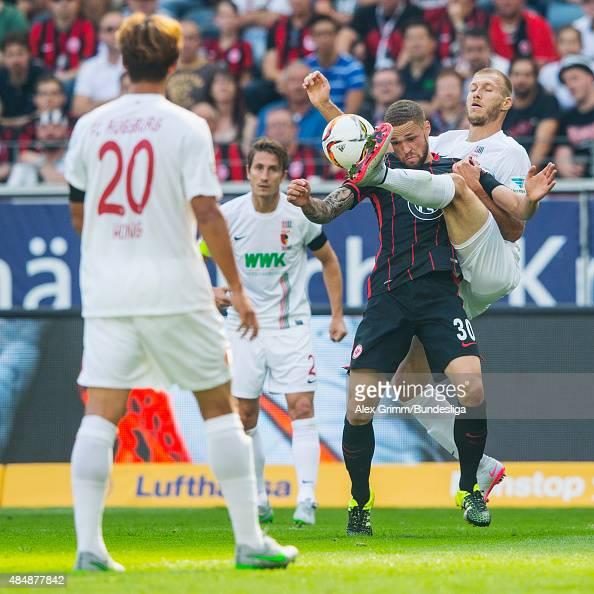 Luc Castaignos of Frankfurt is challenged by Ragnar Klavan of Augsburg during the Bundesliga match between Eintracht Frankfurt and FC Augsburg at...