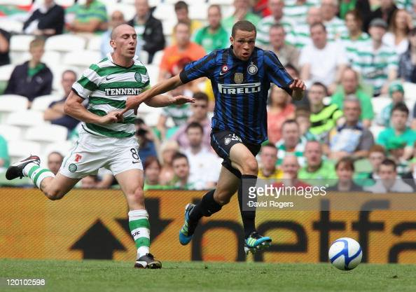 Luc Castaignos of Inter Milan moves away from Scott Brown during the Dublin Super Cup match between Celtic and Inter Milan at the Aviva Stadium on...