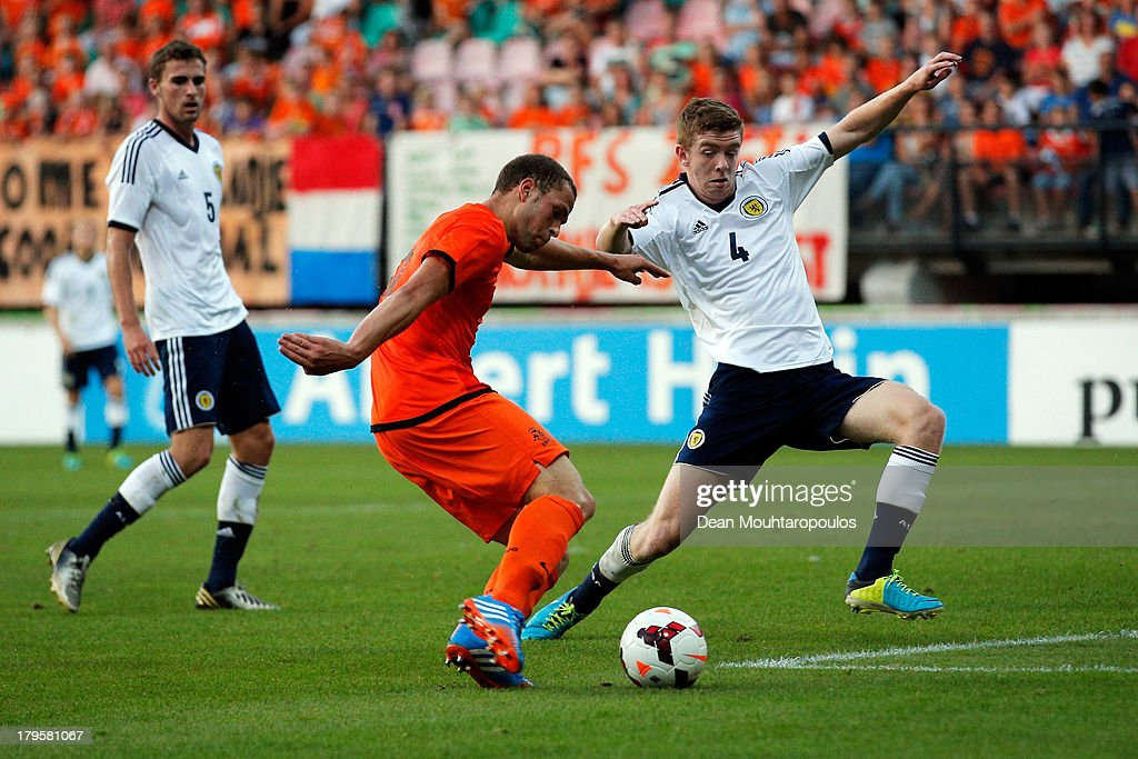 <a gi-track='captionPersonalityLinkClicked' href=/galleries/search?phrase=Luc+Castaignos&family=editorial&specificpeople=5537843 ng-click='$event.stopPropagation()'>Luc Castaignos</a> of Netherlands shoots and scores the second goal of the game with team mates during the 2015 UEFA European U21 Championships Qualifier between Netherlands U21s and Scotland U21s held at De Goffert Stadion on September 5, 2013 in Nijmegen, Netherlands.