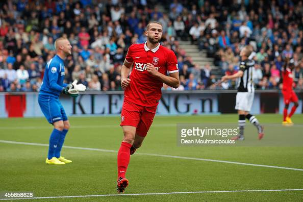 Luc Castaignos of Twente celebrates scoring a goal during the Dutch Eredivisie match between Heracles Almelo and FC Twente at Polman Stadion on...