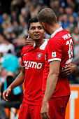 Luc Castaignos of Twente celebrates scoring a goal with Jesus Corona during the Dutch Eredivisie match between Heracles Almelo and FC Twente at...