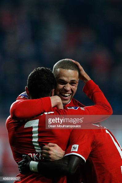 Luc Castaignos of Twente celebrates scoring the second goal of the game with team mate Youness Mokhtar during the Eredivisie match between FC Twente...