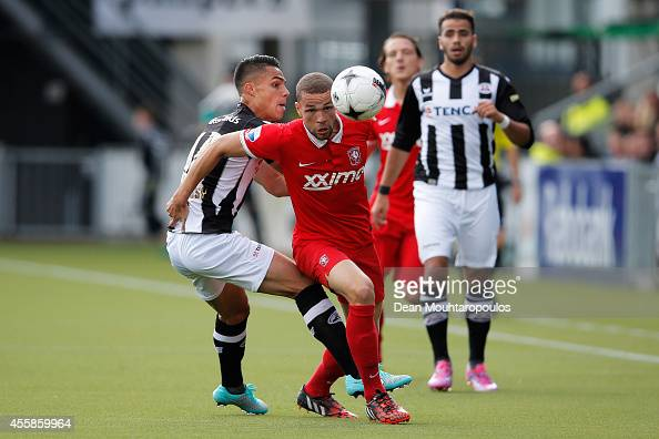 Luc Castaignos of Twente in action against Joey Pelupessy of Heracles during the Dutch Eredivisie match between Heracles Almelo and FC Twente at...