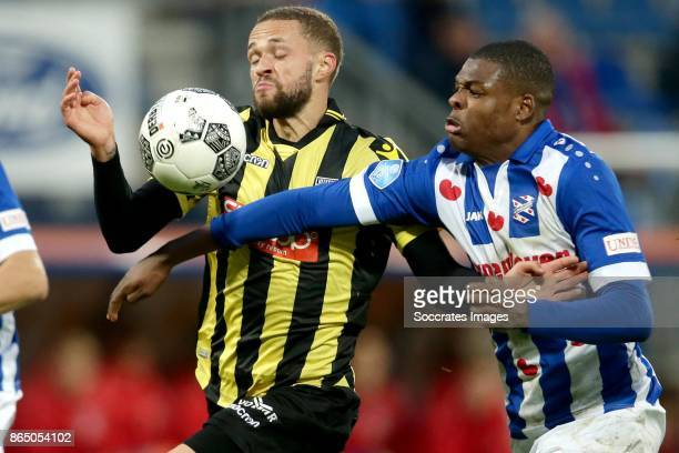 Luc Castaignos of Vitesse Denzel Dumfries of SC Heerenveen during the Dutch Eredivisie match between SC Heerenveen v Vitesse at the Abe Lenstra...