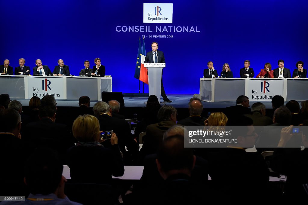 Luc Chatel (C), special advisor of Les Republicains (LR) right-wing party president, gives a speech during the LR National Council on February 13, 2016 in Paris. AFP PHOTO / LIONEL BONAVENTURE / AFP / LIONEL BONAVENTURE