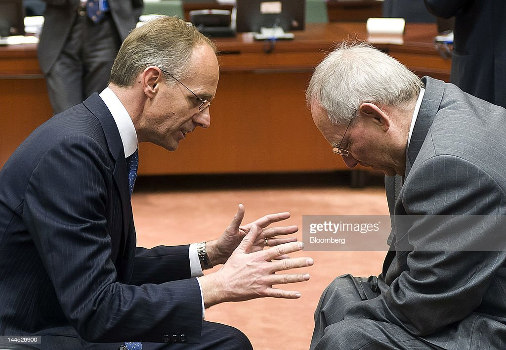 <a gi-track='captionPersonalityLinkClicked' href=/galleries/search?phrase=Luc+Frieden&family=editorial&specificpeople=651276 ng-click='$event.stopPropagation()'>Luc Frieden</a>, Luxembourg's finance minister, left, gestures as he speaks with Wolfgang Schaeuble, Germany's finance minister, ahead of a European Union (EU) finance ministers meeting at the European Council headquarters in Brussels, Belgium, on Tuesday, May 15, 2012. European Union finance ministers are making a renewed attempt to hammer out an accord on boosting the amount of capital and liquid assets that must be held by the region's banks after the U.K. rejected a previous compromise. Photographer: Jock Fistick/Bloomberg via Getty Images