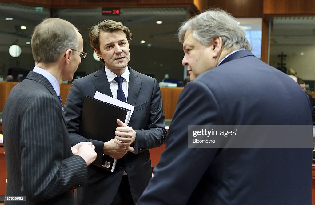 <a gi-track='captionPersonalityLinkClicked' href=/galleries/search?phrase=Luc+Frieden&family=editorial&specificpeople=651276 ng-click='$event.stopPropagation()'>Luc Frieden</a>, Luxembourg's finance minister, left, listens as <a gi-track='captionPersonalityLinkClicked' href=/galleries/search?phrase=Francois+Baroin&family=editorial&specificpeople=552822 ng-click='$event.stopPropagation()'>Francois Baroin</a>, France's finance minister, center, speaks with <a gi-track='captionPersonalityLinkClicked' href=/galleries/search?phrase=Evangelos+Venizelos&family=editorial&specificpeople=2820810 ng-click='$event.stopPropagation()'>Evangelos Venizelos</a>, Greece's finance minister, ahead of a meeting of European Union (EU) finance ministers at the European Council headquarters in Brussels, Belgium, on Tuesday, Jan. 24, 2012. European finance ministers balked at putting up more public money for Greece, calling on bondholders to provide greater debt relief in order to point the way out of the two-year-old debt crisis. Photographer: Jock Fistick/Bloomberg via Getty Images