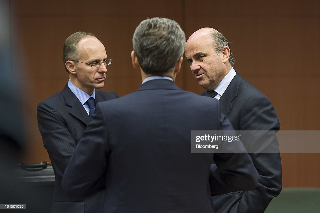 <a gi-track='captionPersonalityLinkClicked' href=/galleries/search?phrase=Luc+Frieden&family=editorial&specificpeople=651276 ng-click='$event.stopPropagation()'>Luc Frieden</a>, Luxembourg's finance minister, left, Vittorio Grilli, Italy's finance minister, center, and <a gi-track='captionPersonalityLinkClicked' href=/galleries/search?phrase=Luis+de+Guindos&family=editorial&specificpeople=8756055 ng-click='$event.stopPropagation()'>Luis de Guindos</a> Jurado, Spain's finance minister, speak ahead of the eurogroup meeting in Brussels, Belgium, on Sunday, March 24, 2013. Cyprus's fate hangs in the balance as euro-area finance ministers meet today to decide whether the tiny Mediterranean island has done enough for a bailout that will avert its financial collapse. Photographer: Jock Fistick/Bloomberg via Getty Images