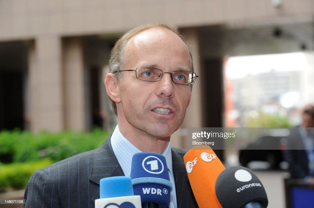 <a gi-track='captionPersonalityLinkClicked' href=/galleries/search?phrase=Luc+Frieden&family=editorial&specificpeople=651276 ng-click='$event.stopPropagation()'>Luc Frieden</a>, Luxembourg's finance minister, speaks to the media as he arrives ahead of the Eurogroup meeting at the European Council headquarters in Brussels, Belgium, on Monday, July 9, 2012. European finance ministers were gathering to work out crisis measures after leaders agreed last month to ease access to direct financing for banks and bailout mechanisms. Photographer: Jock Fistick/Bloomberg via Getty Images