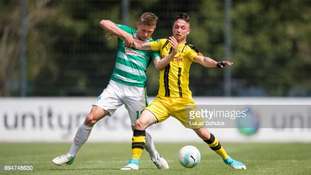 Luc Ihorst of Bremen and Tobias Missner of Dortmund fight for the ball during the B Juniors German Championship Semi Final match between Borussia...