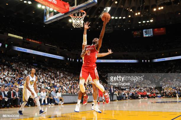 Luc Mbah a Moute of the Houston Rockets goes to the basket against the Golden State Warriors on October 17 2017 at ORACLE Arena in Oakland California...