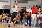 Luc Mbah a Moute of the Milwaukee Bucks drives against James Johnson of the Chicago Bulls during NBA Summer League presented by EA Sports on July 15...