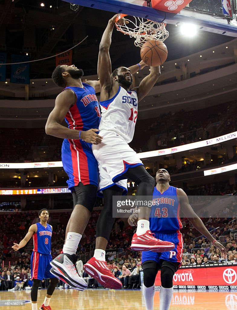 Luc Mbah a Moute #12 of the Philadelphia 76ers dunks the ball with Andre Drummond #0 of the Detroit Pistons defending on the play on January 28, 2015 at the Wells Fargo in Philadelphia, Pennsylvania. The 76ers defeated the Pistons 89-69.