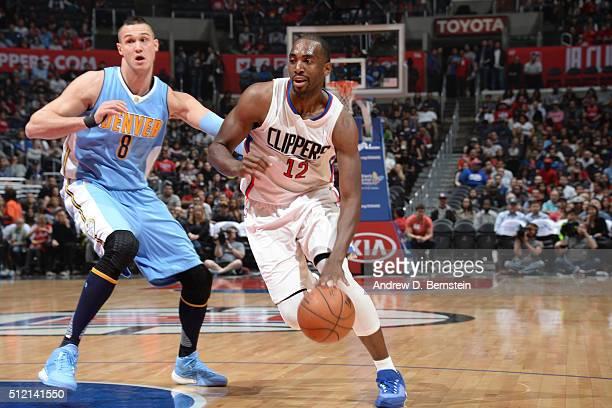 Luc Richard Mbah a Moute of the Los Angeles Clippers drives to the basket against Danilo Gallinari of the Denver Nuggets during the game on February...