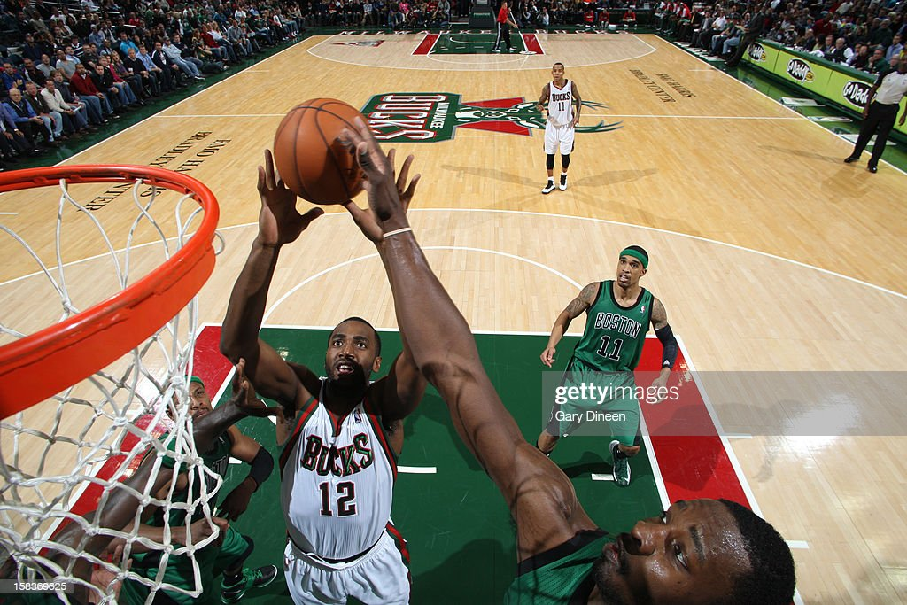 Luc Richard Mbah a Moute #12 of the Milwaukee Bucks grabs the rebound against the Boston Celtics on December 1, 2012 at the BMO Harris Bradley Center in Milwaukee, Wisconsin.