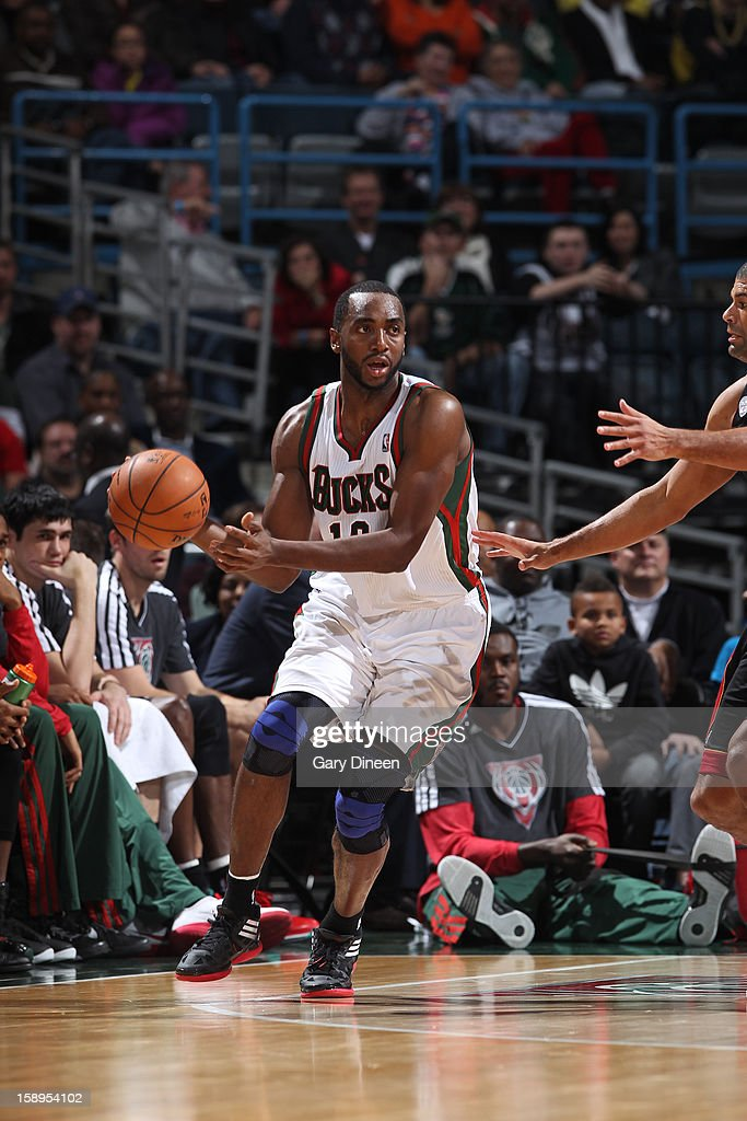 <a gi-track='captionPersonalityLinkClicked' href=/galleries/search?phrase=Luc+Richard+Mbah+a+Moute&family=editorial&specificpeople=699041 ng-click='$event.stopPropagation()'>Luc Richard Mbah a Moute</a> #12 of the Milwaukee Bucks handles the ball against the Miami Heat on December 29, 2012 at the BMO Harris Bradley Center in Milwaukee, Wisconsin.