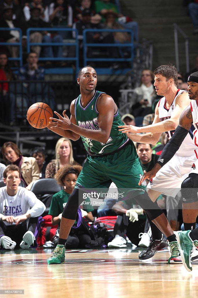 Luc Richard Mbah a Moute #12 of the Milwaukee Bucks looks to pass against Kyle Korver #26 of the Atlanta Hawks on February 23, 2013 at the BMO Harris Bradley Center in Milwaukee, Wisconsin.