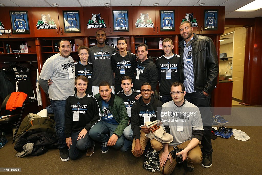 Luc Richard Mbah a Moute #12 of the Minnesota Timberwolves poses for pictures with fans before the game against the Milwaukee Bucks on March 11, 2014 at Target Center in Minneapolis, Minnesota.