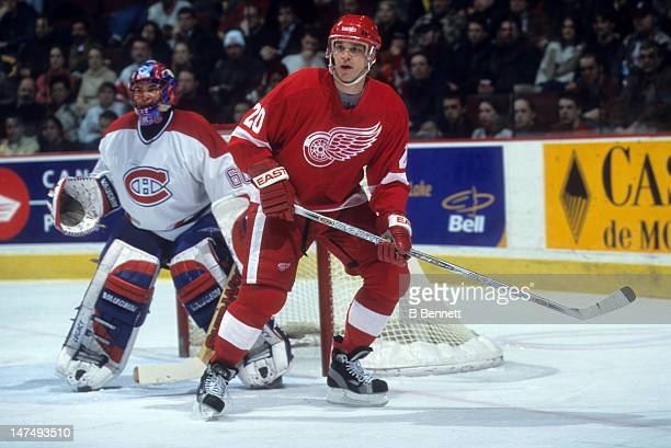Luc Robitaille of the Detroit Red Wings sets up in front of goalie Jose Theodore of the Montreal Canadiens on February 11 2002 at the Molson Centre...