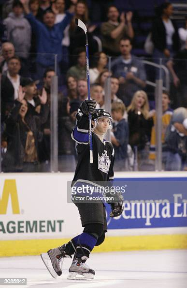 Luc Robitaille of the Los Angeles Kings acknowledges the fans after defeating the Mighty Ducks of Anaheim 51 on March 14 2004 at Staples Center in...