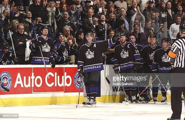 Luc Robitaille of the Los Angeles Kings waves to the crowd after scoring his 551st goal with the Los Angeles Kings organization to pass Marcel Dionne...
