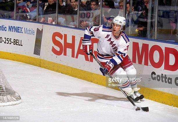 Luc Robitaille of the New York Rangers skates with the puck during an NHL game in January 1996 at the Madison Square Garden in New York New York