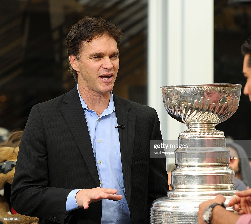 Luc Robitaille stands next to the Stanley Cup at 'Extra' at The Grove on October 11, 2012 in Los Angeles, California.